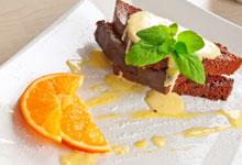 Orange in syrup for decoration of desserts