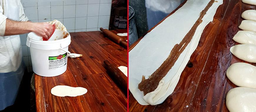 Aplicación de cabello de ángel en ensaimada hecha en pastelería industrial.