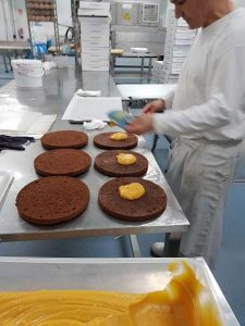 Application of apricot jam on sacher cake