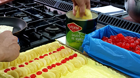 Making an apple pie with Lazaya's delicious apples in syrup cut in segments.
