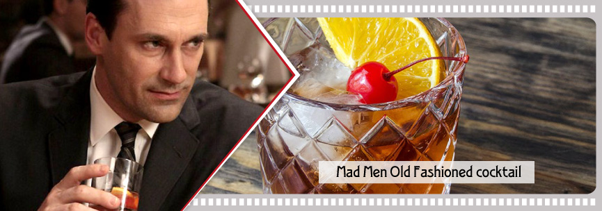 Don Draper in Mad Men having his fave cocktail with a glace cherry and an orange slice.