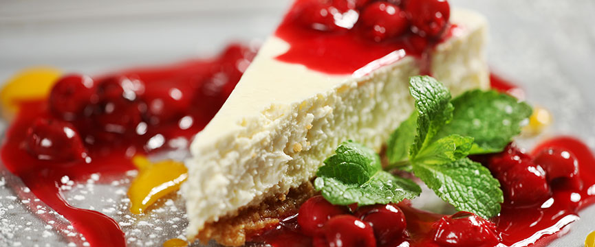 A slice of cherry cheesecake, one of the best-known cakes with candied fruits all over the world.