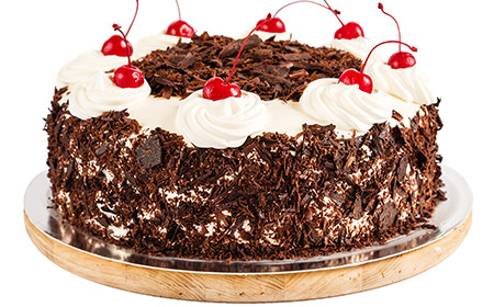Black Forest cherry cakes with candied fruits resemble the colours of traditional women clothes in south Germany.